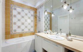 Названы способы сэкономить на плитке в ванной